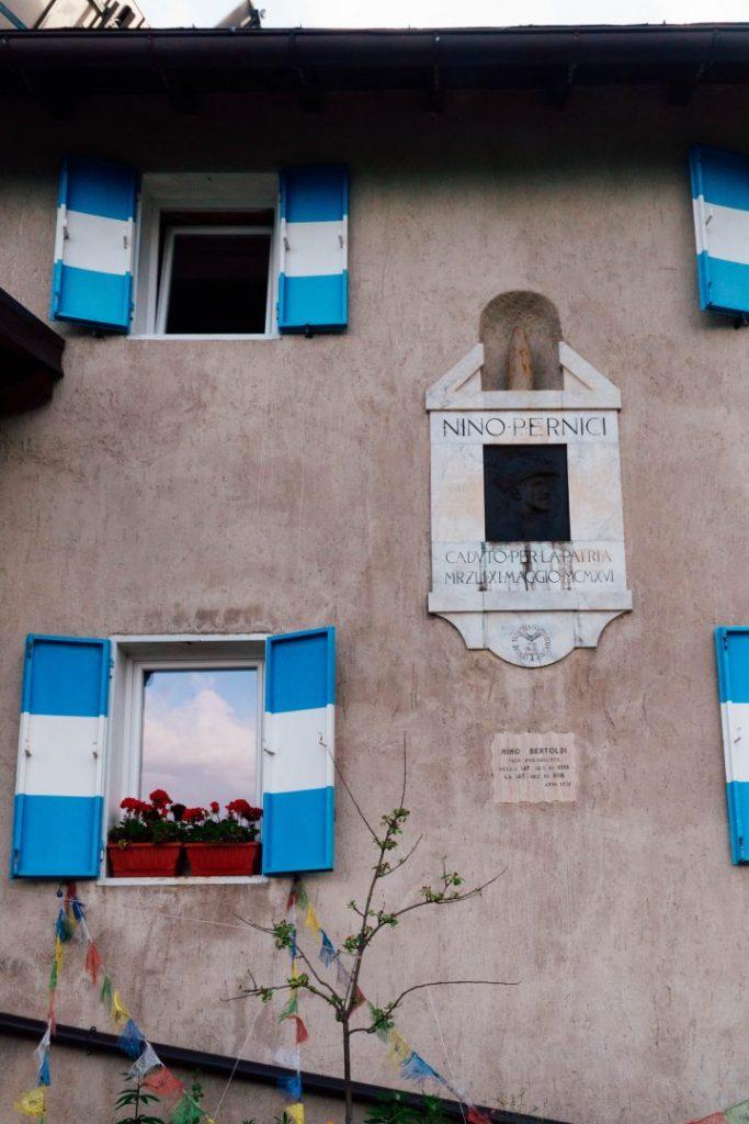 Blue at white shutters of Rifugio Nino Pernici in Valle di Ledro, Italy