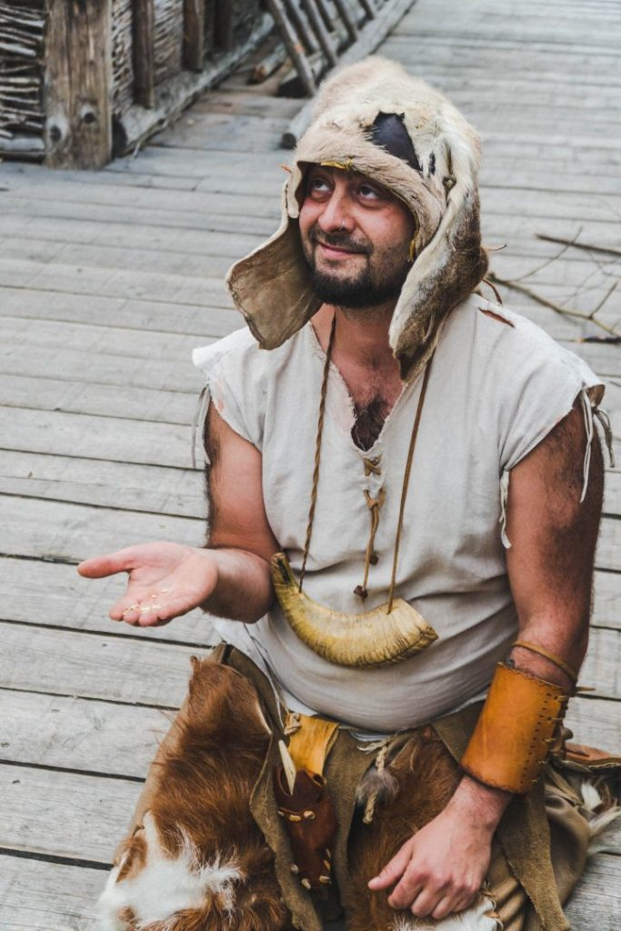 Bacmor the prehistoric man holding out some ground flour