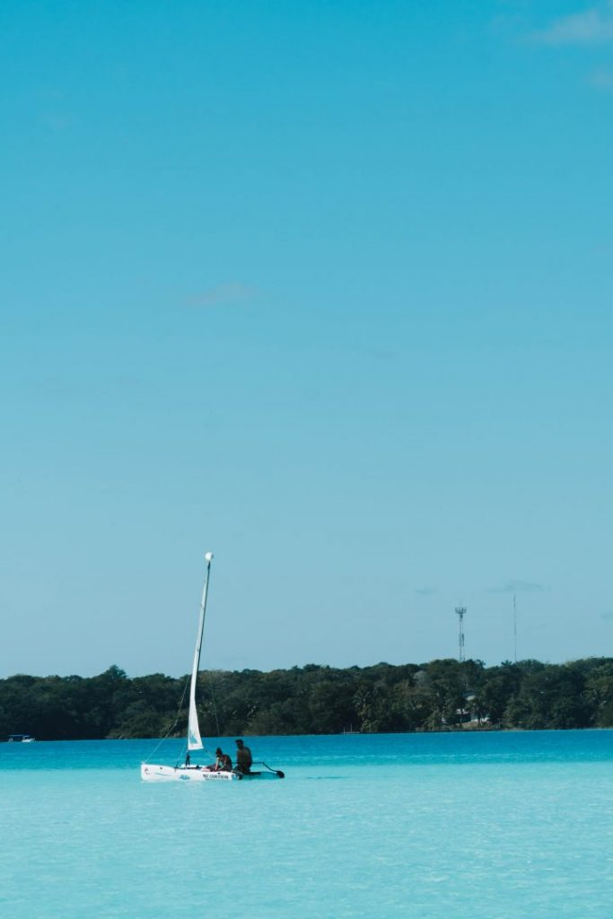 A boat on the bright blue Bacalar Lagoon