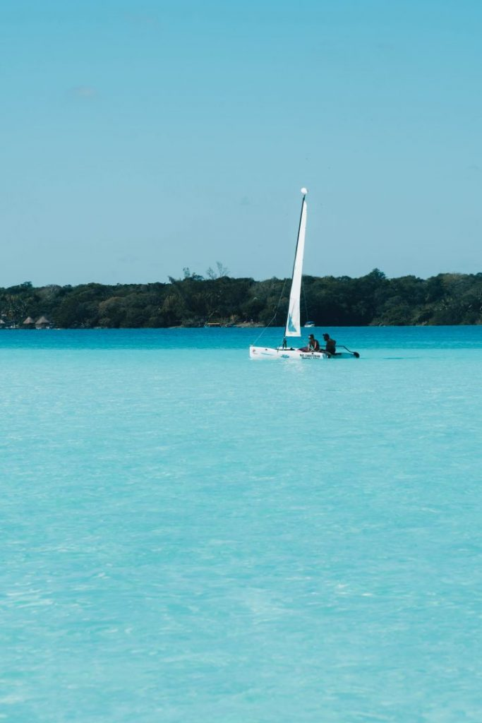 A catamaran on the bright blue Bacalar lagoon
