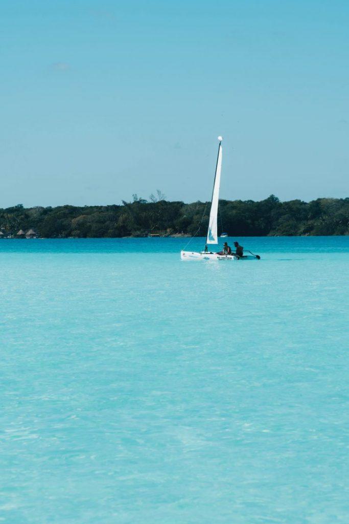 A catamaran on the bright blue Bacalar lagoon