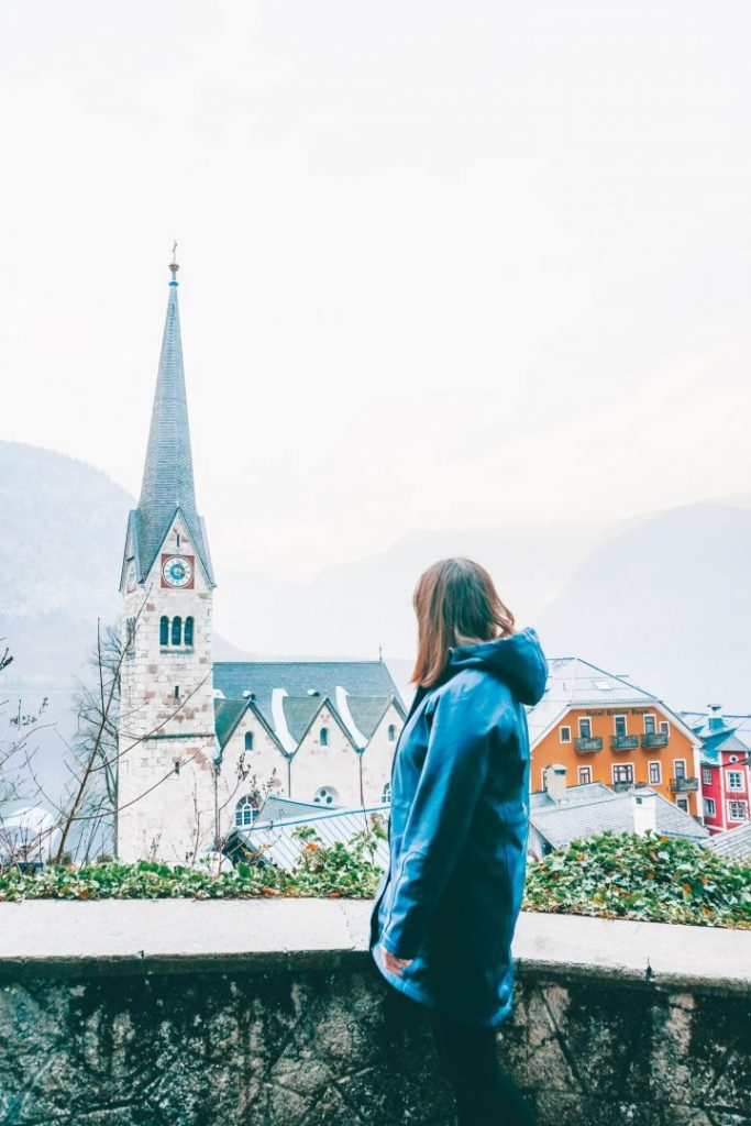 Addie looking into the frame in Hallstatt, Austria