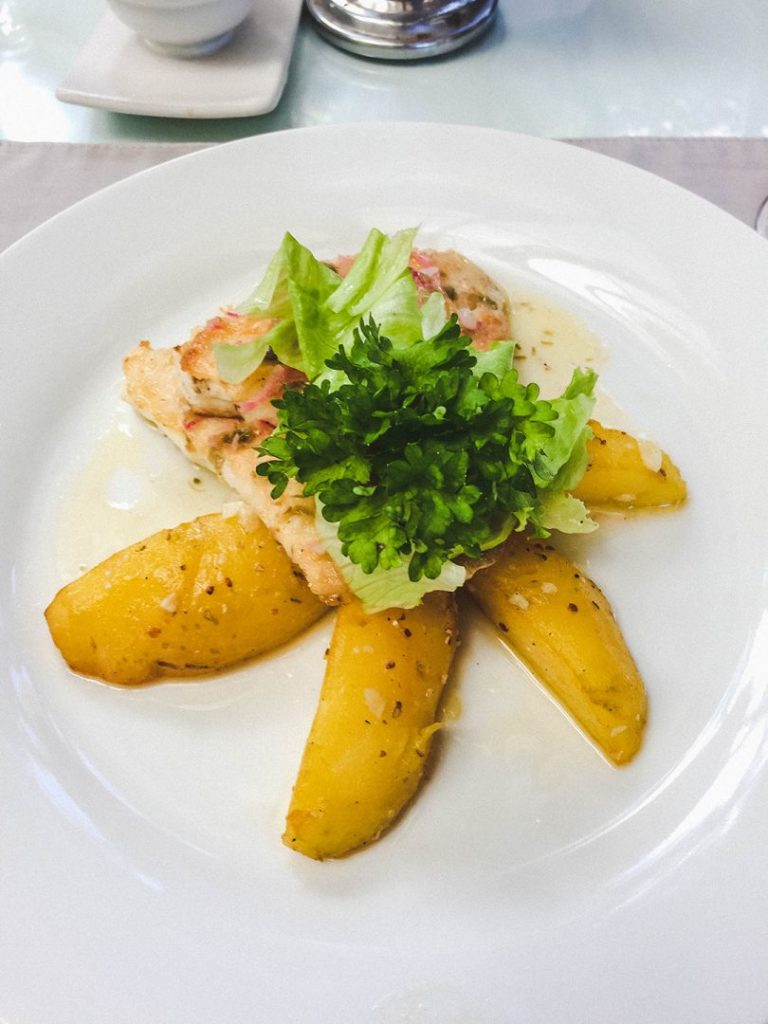 Delicious fish and potatoes at the Oasis Restaurant included in our safari of Seminyak spas