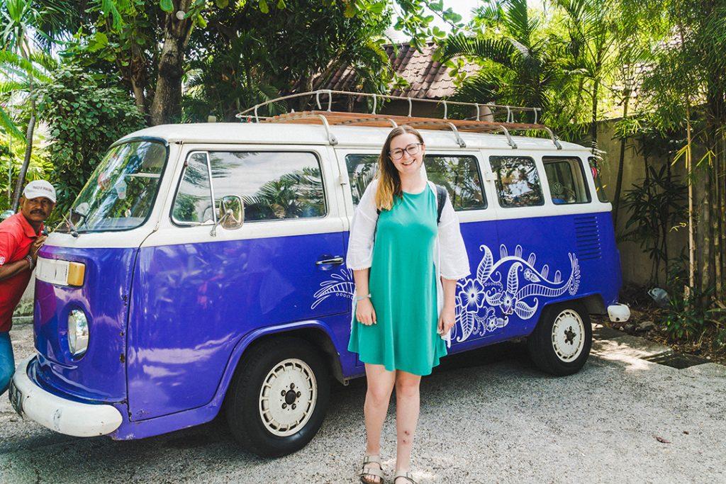 Addie in front of a purple VW Kombi