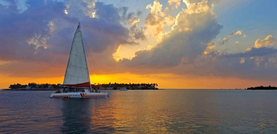 A sailboat at sunset in Key West, Florida - one of the best fall vacations in the US!