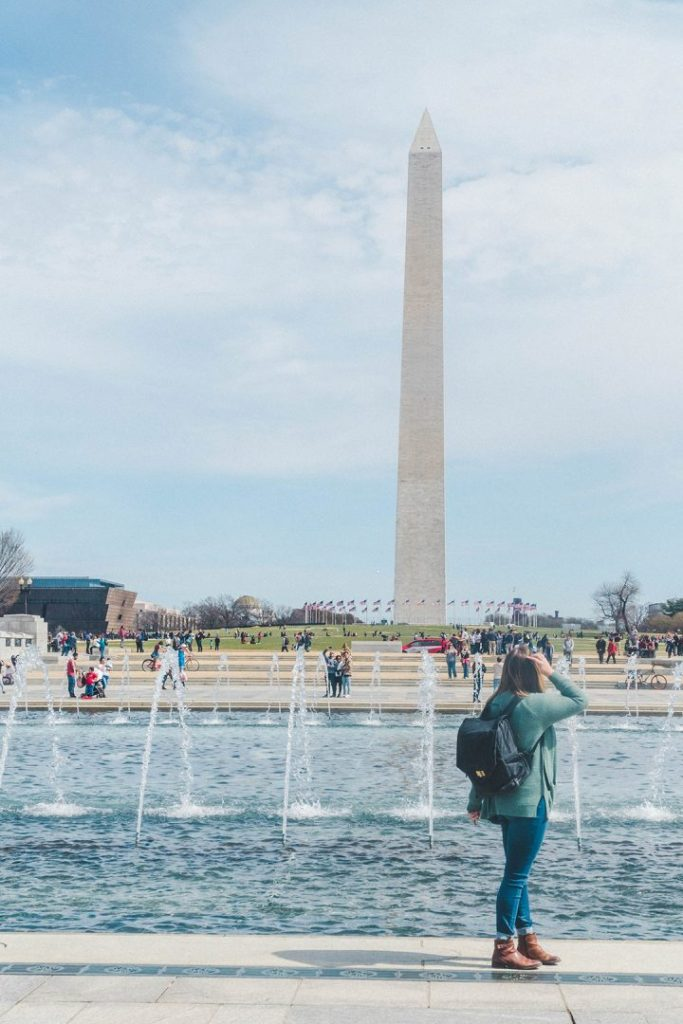 Addie looking back at the Washington Monument while in the plaza of the WWII Memorial on the National Mall