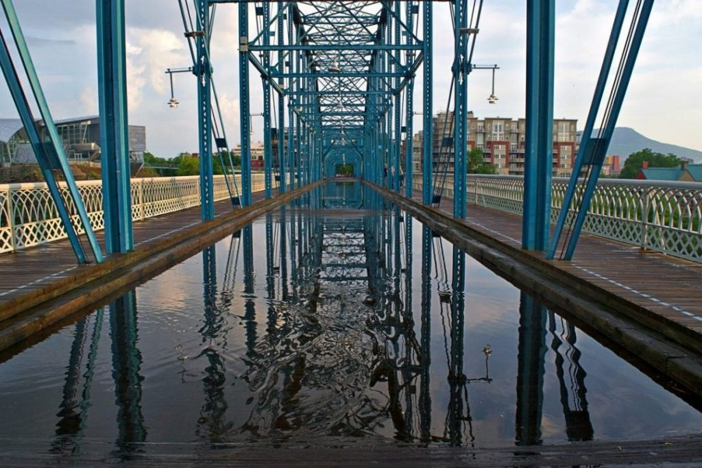 Water reflecting the Walnut Street Bridge in Chattanooga, TN