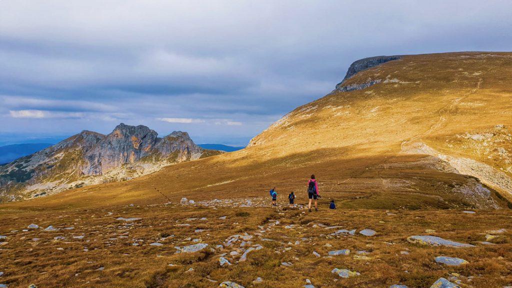 People hiking in the Rila Mountains, Bulgaria, Europe in the fall