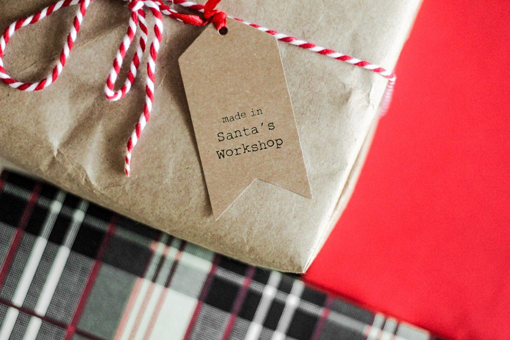 a wrapped gift box - travel gifts for her