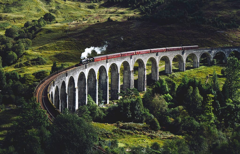A train going over a viaduct in Europe