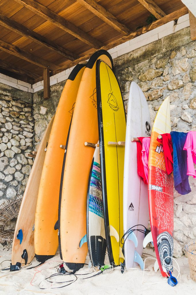 Surf boards lined up for bali surf camp