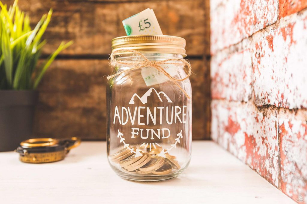 adventure fund mason jar - one of the best travel gifts for her!