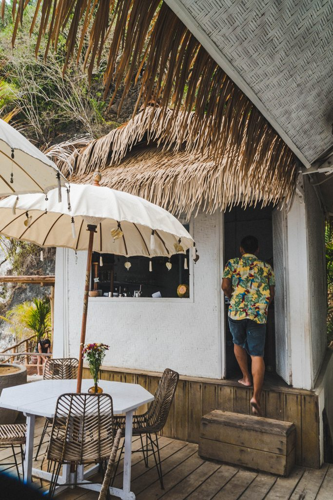 A waiter walking into the kitchen at this bali surf camp cafe