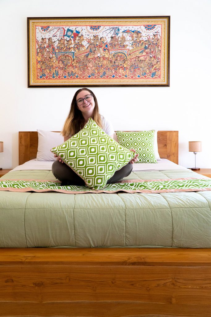addie smiling on the bed in her ubud hotel