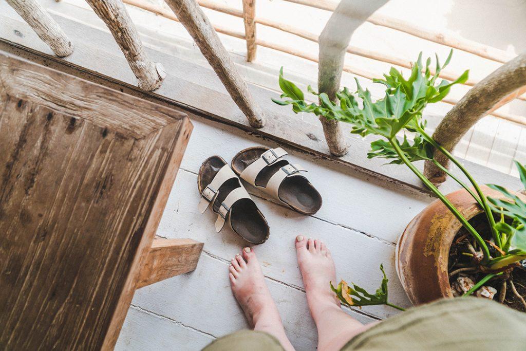 Addie kicking off her birkenstocks on the terrace