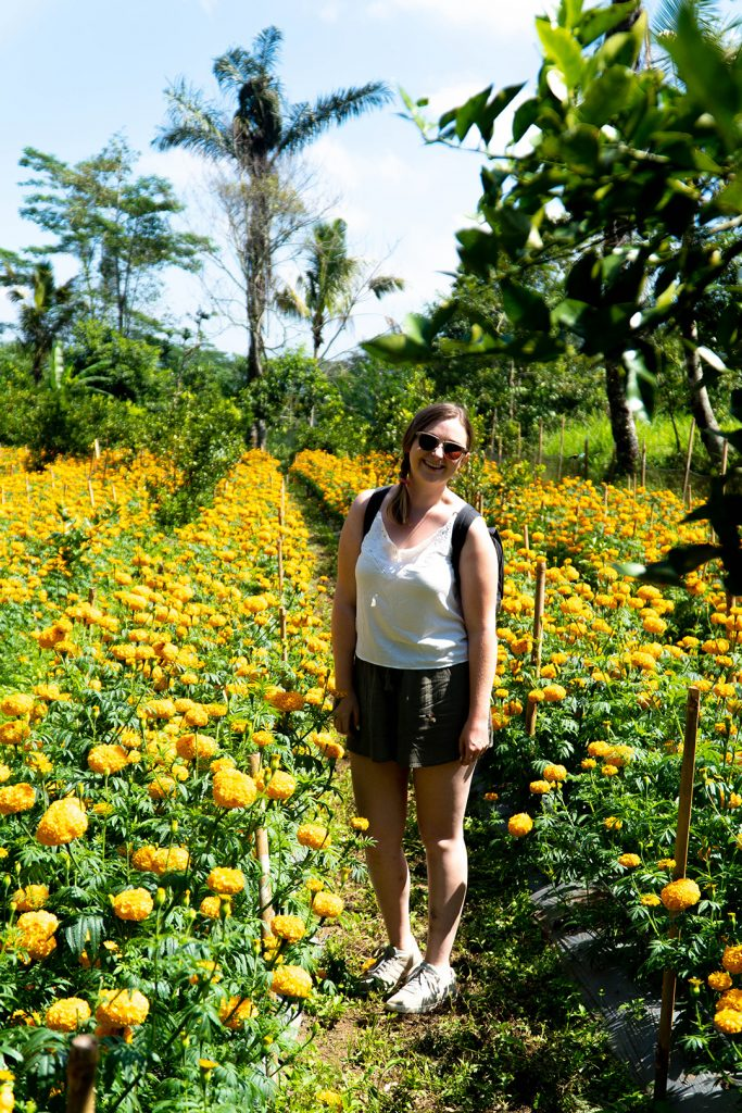 Addie standing in field of magnolias