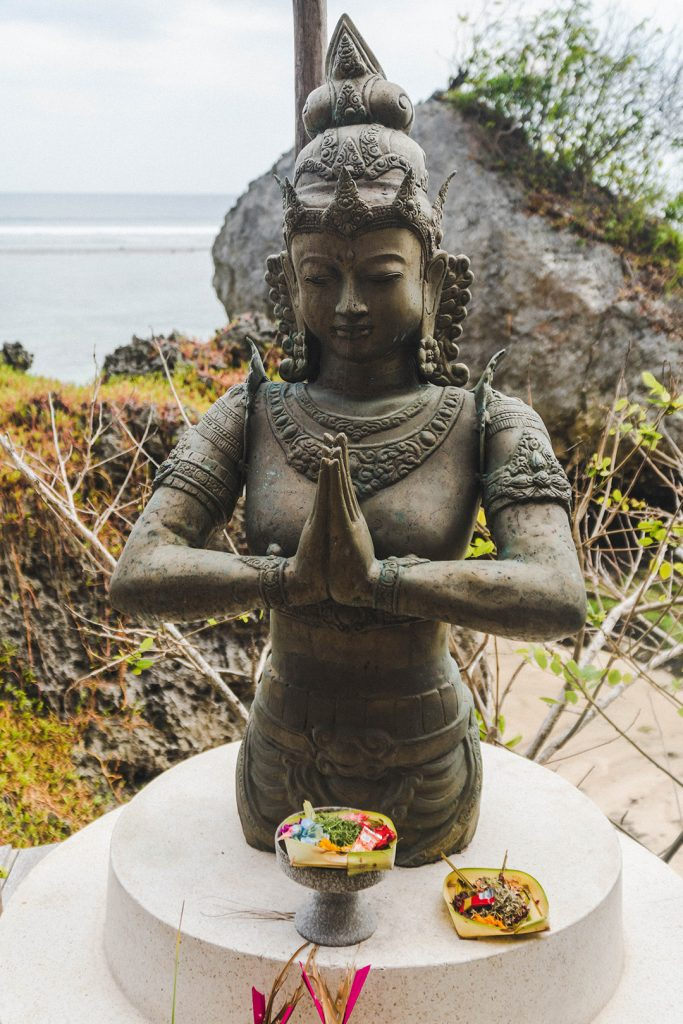 A statue with offering at Dreamsea Uluwatu