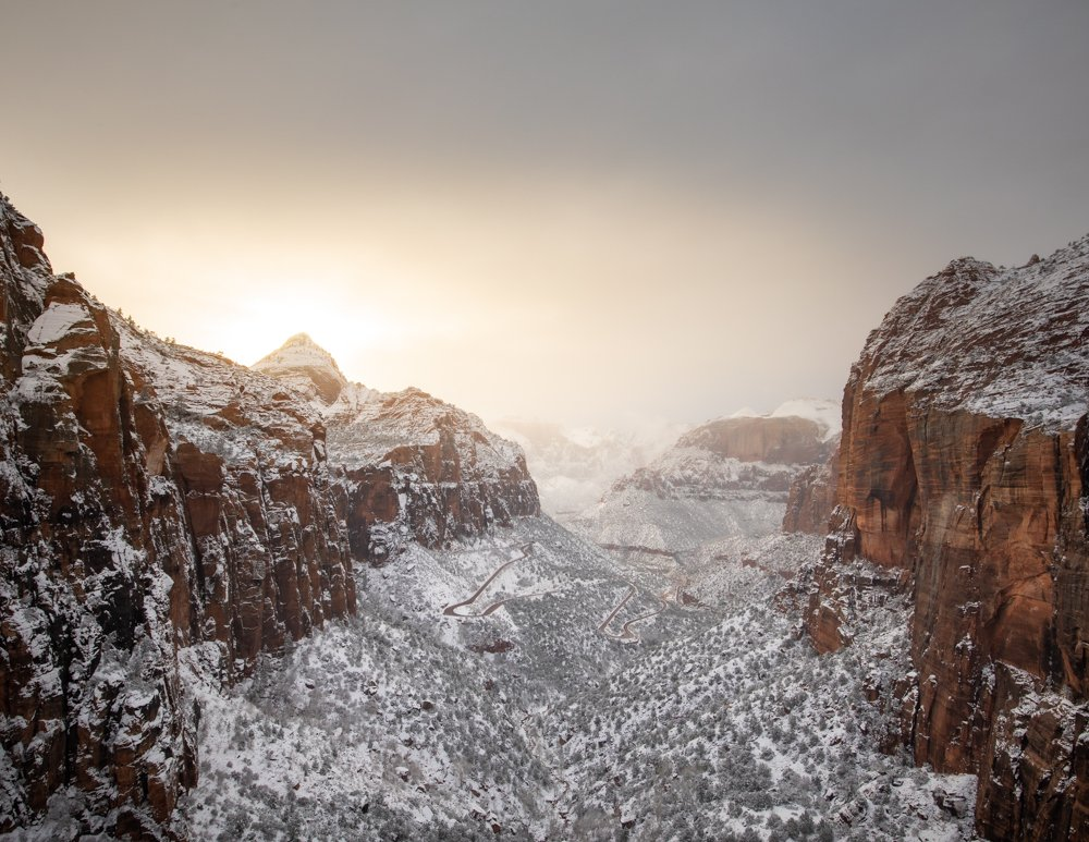 red mountains covered in snow in zion national park in winter - one of the most beautiful places to visit in winter in USA