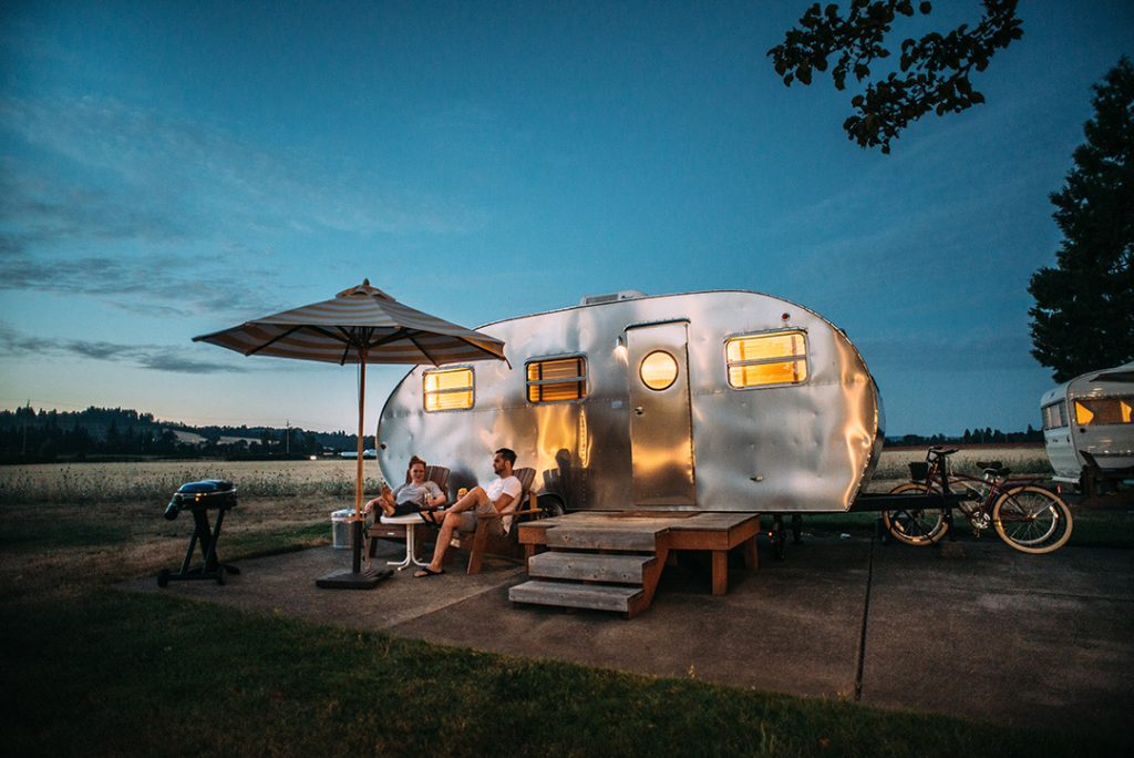 A metal camper - an Airbnb gift card makes a great travel gift for her!