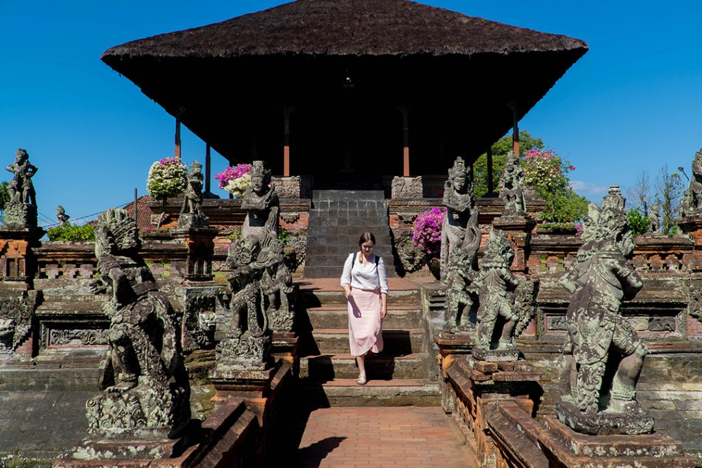Addie walking down the steps of a temple near Ubud