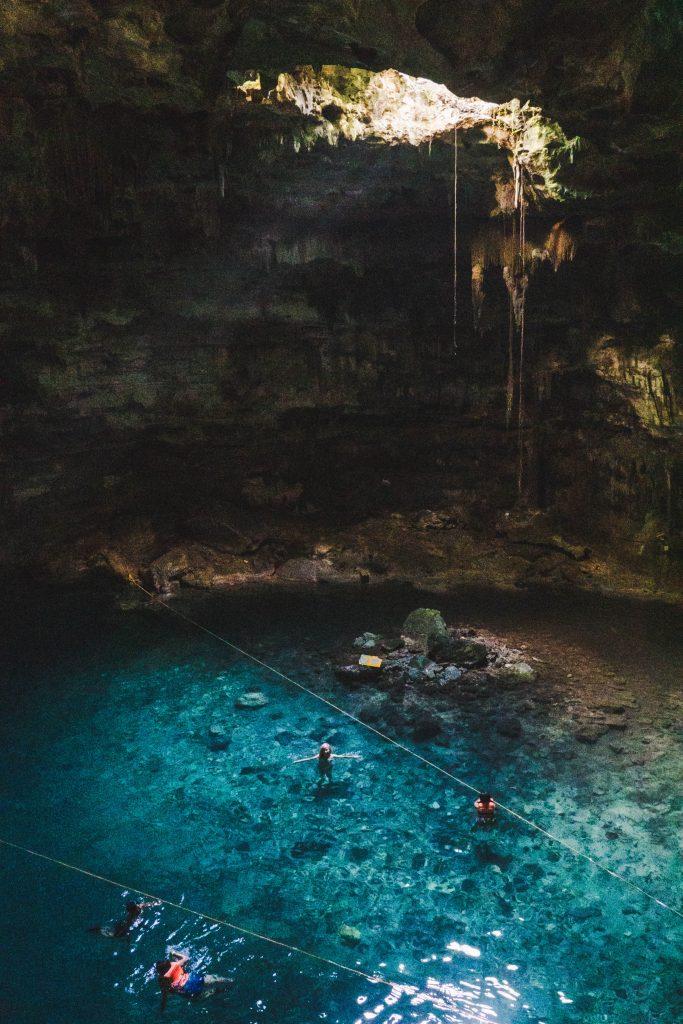 blue water at cenote samula, a lake inside a cave