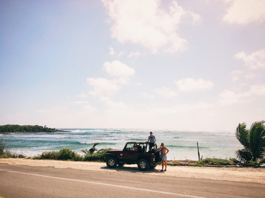 two guys and a jeep by the ocean in Cozumel, Mexico