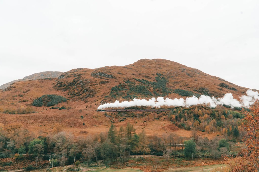 the jacobite steam train on a hill during an isle of skye tour from edinburgh
