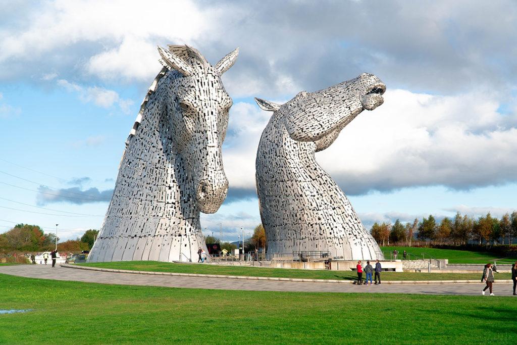 2 silver horse head statues