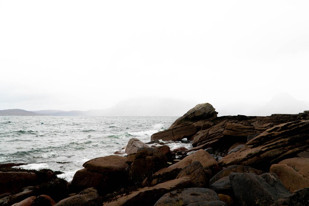 rocks rising from the ocean at elgol on the isle of skye