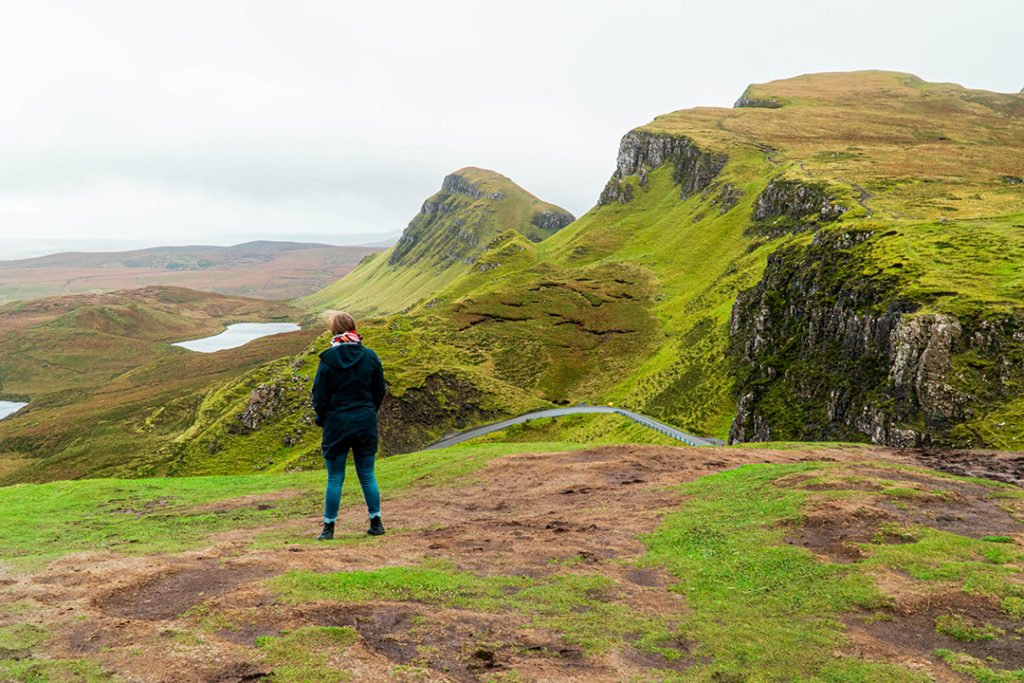 addie standing in front of the rolling hills of the quiraing on the isle of skye