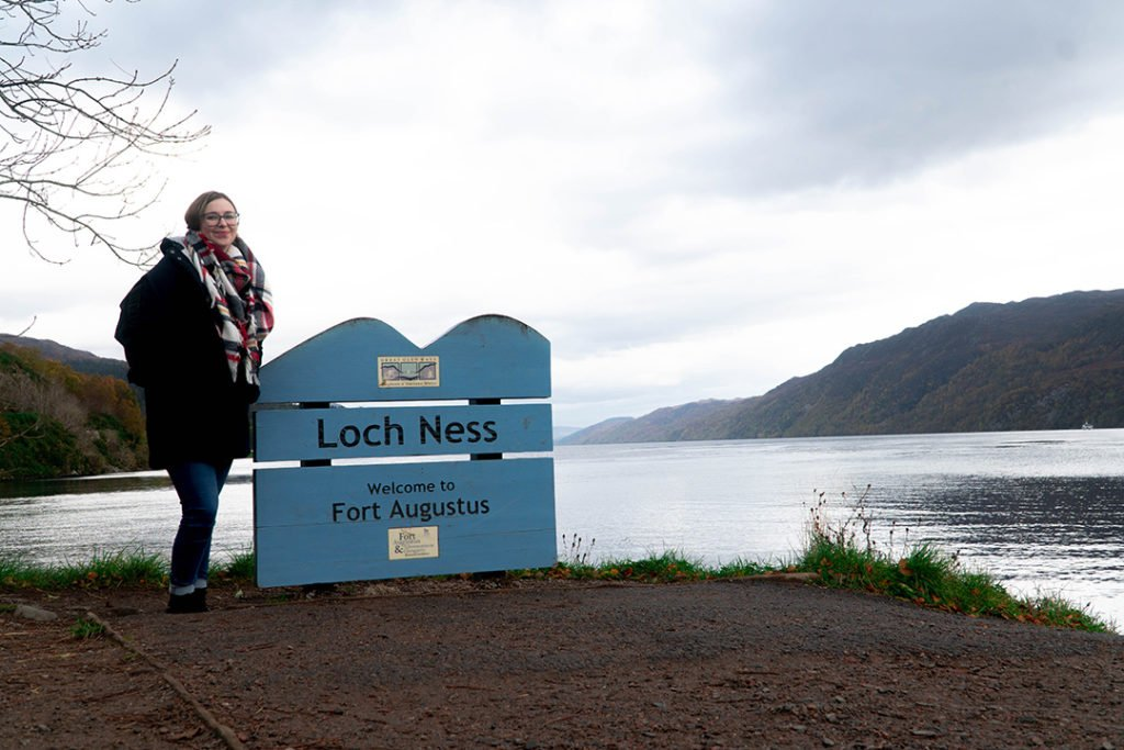 addie standing by the loch ness sign, a stop on the Rabbie's Isle of Skye tour from Edinburgh