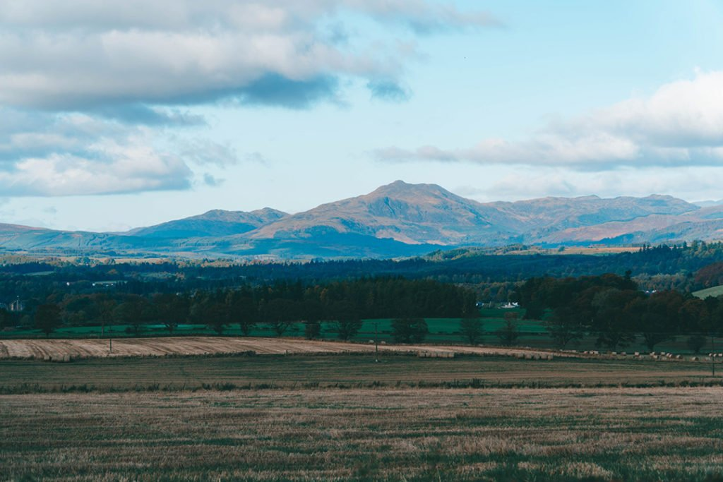 A view across a field to mountains in the background