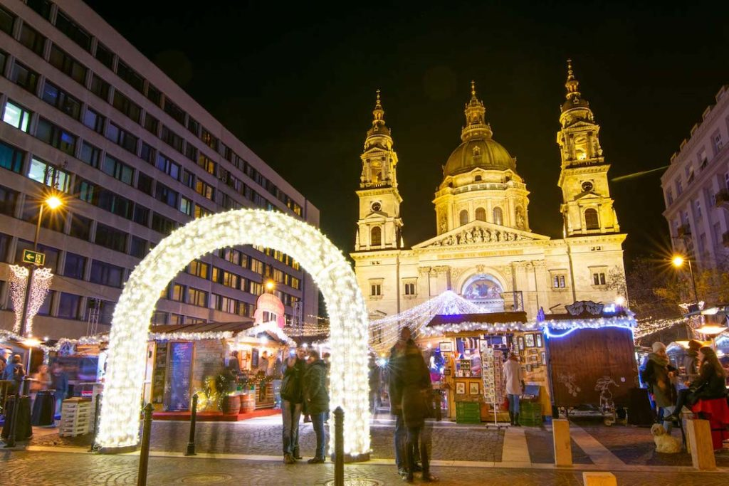 a christmas market lit up at night in Budapest, Hungary - one of the best places to visit in Europe in winter