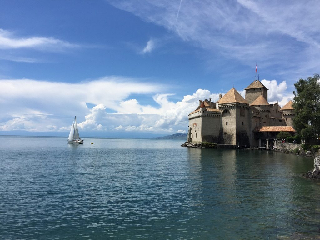 A castle on the edge of a lake in Montreux, Switzerland