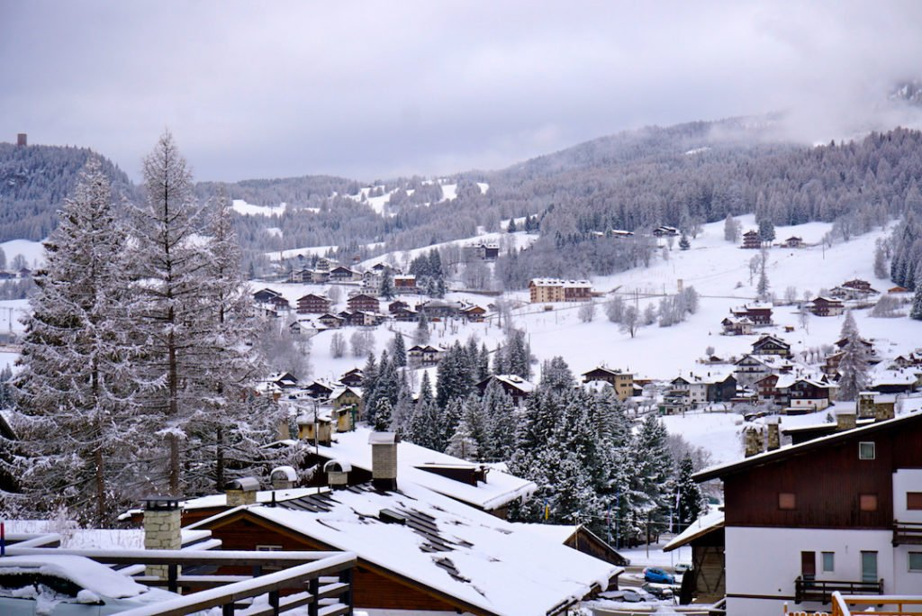 A small alpine town covered in snow. Cortina d'Ampezzo in the Italian Dolomites is one of the best places to visit in europe in winter
