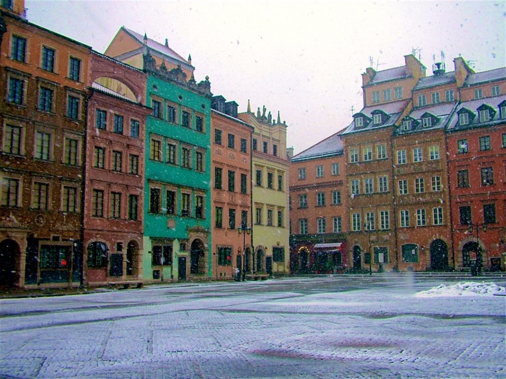 colorful houses in the snow in a square in Warsaw, Poland