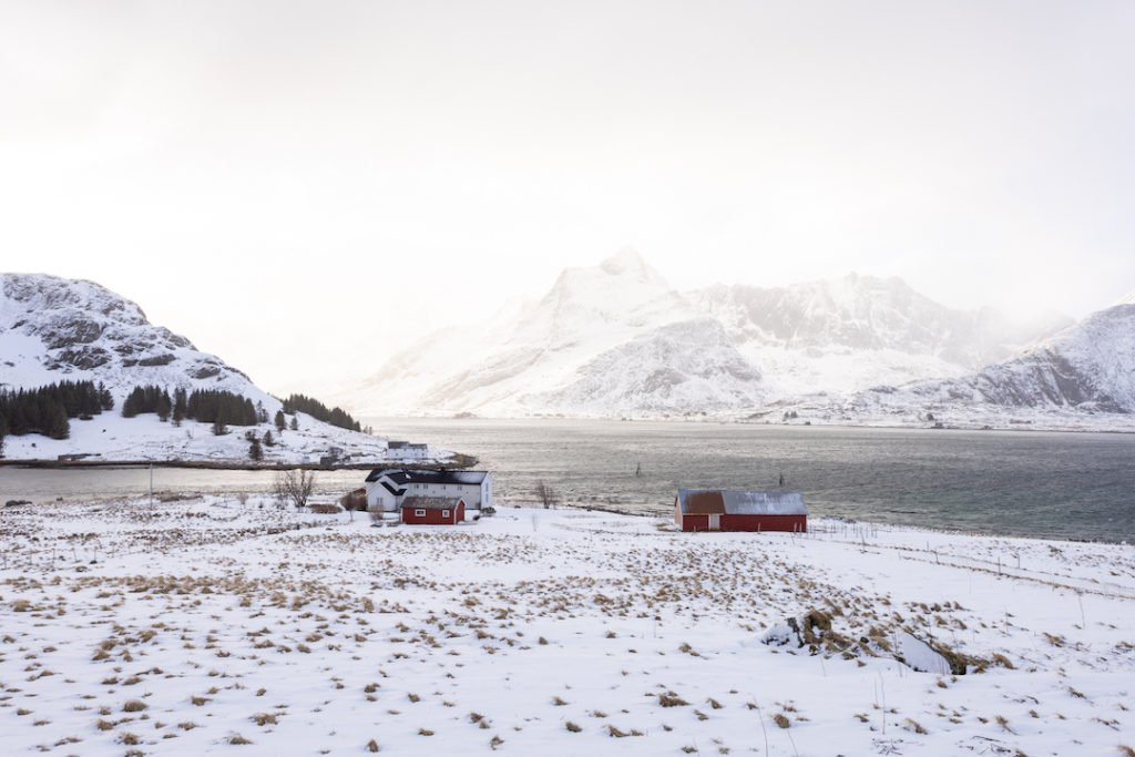 small red cabins in the snowy mountain landscape of the Lofoten Islands in Norway