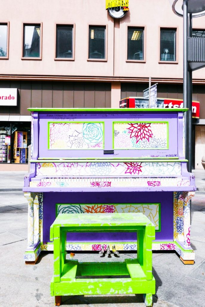 a colorful painted piano on Denver's 16th Street Mall