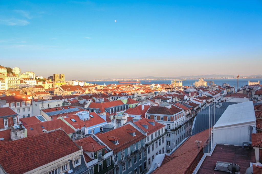 sunset over the red rooftops of Lisbon, Portugal