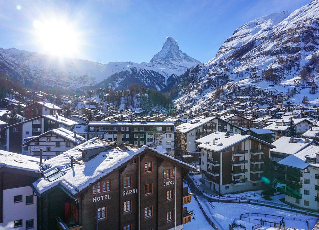 The sun over the town of Zermatt and the Matterhorn