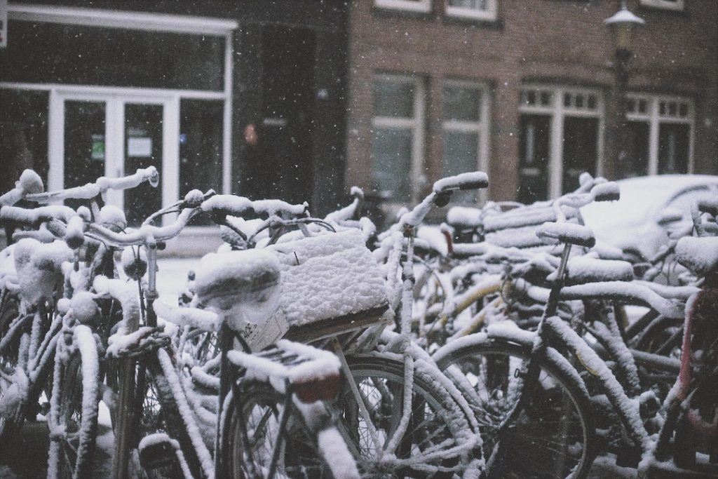 bikes covered in snow in Amsterdam, the Netherlands - one of the best places to visit in Europe in winter