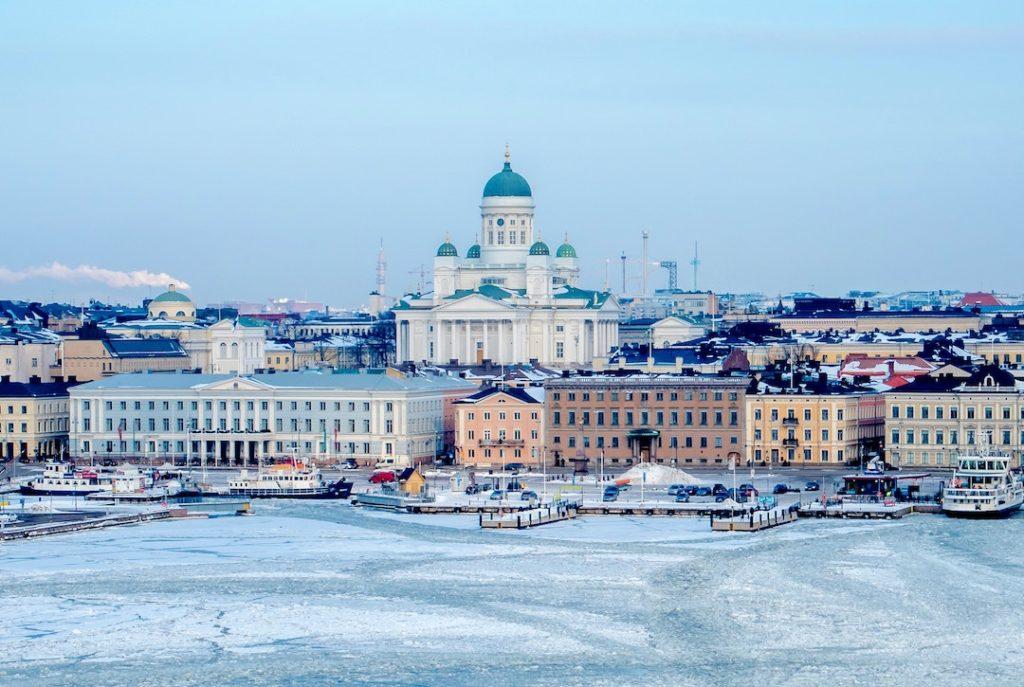 They skyline of Helsinki by a frozen lake