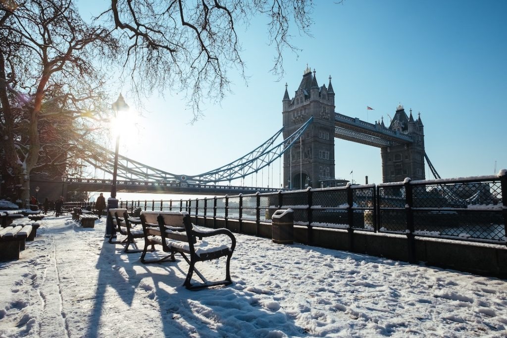 tower bridge in the snow. London is one of the best places to visit in Europe in winter!