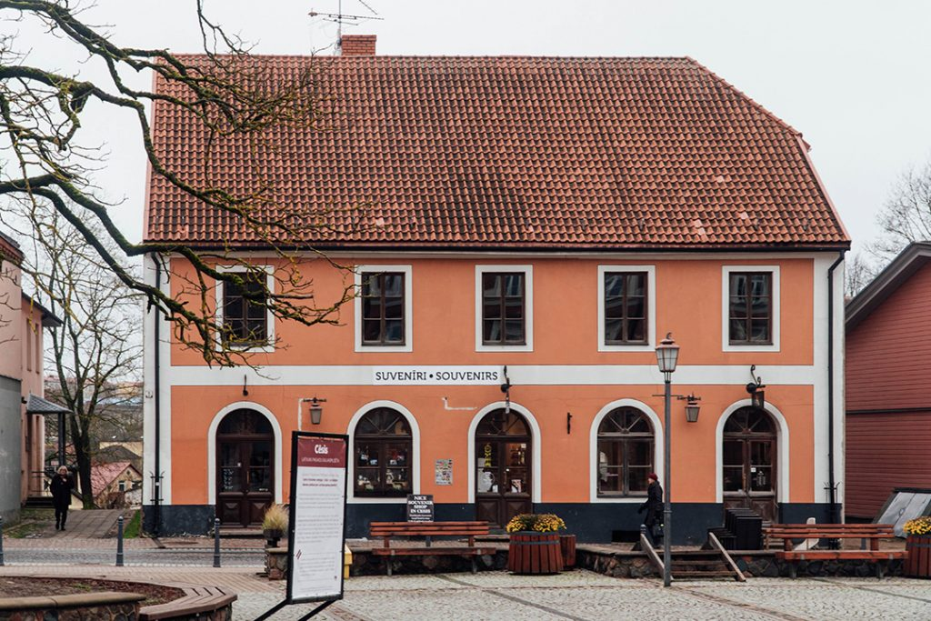 an orange building in old town cesis, latvia, one of the best solo female travel destinations