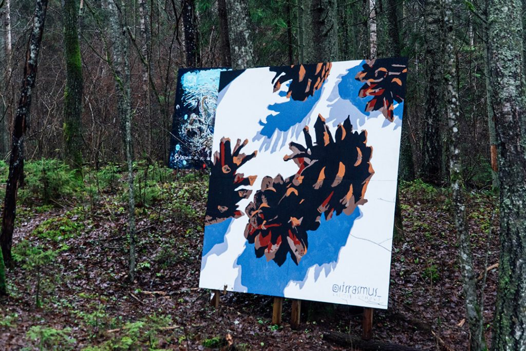a large painting of pine cones in the woods
