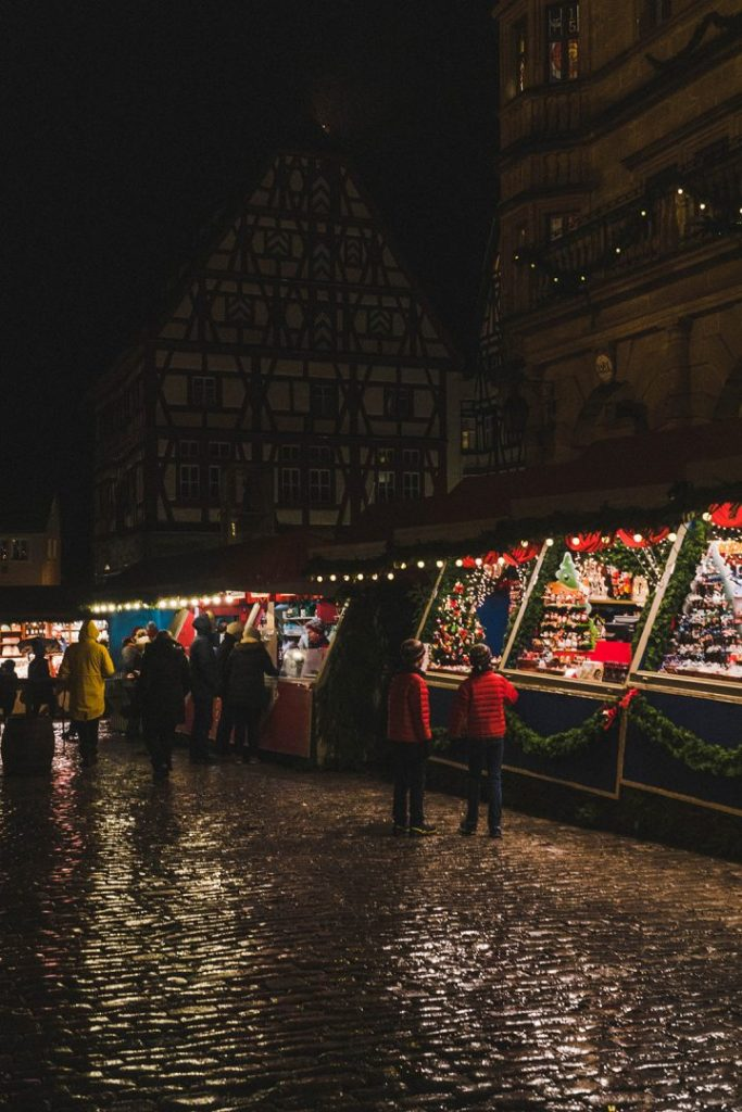 A row of lit up christmas market stalls