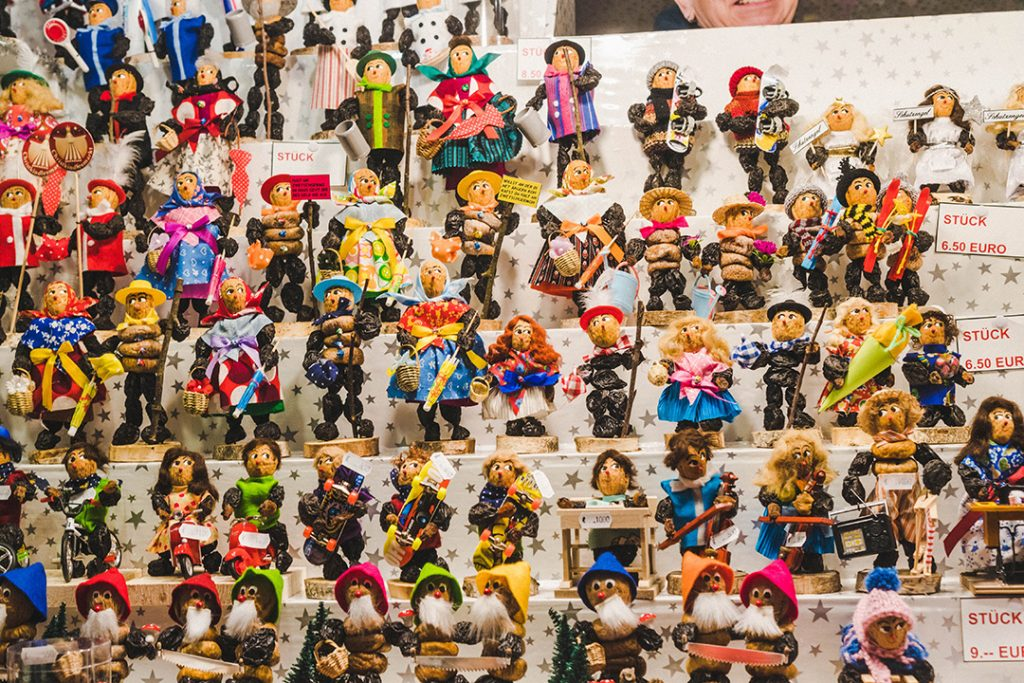 many shelves full of small dolls made out of prunes and walnuts