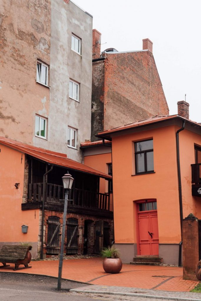 a tilting orange house in cesis old town
