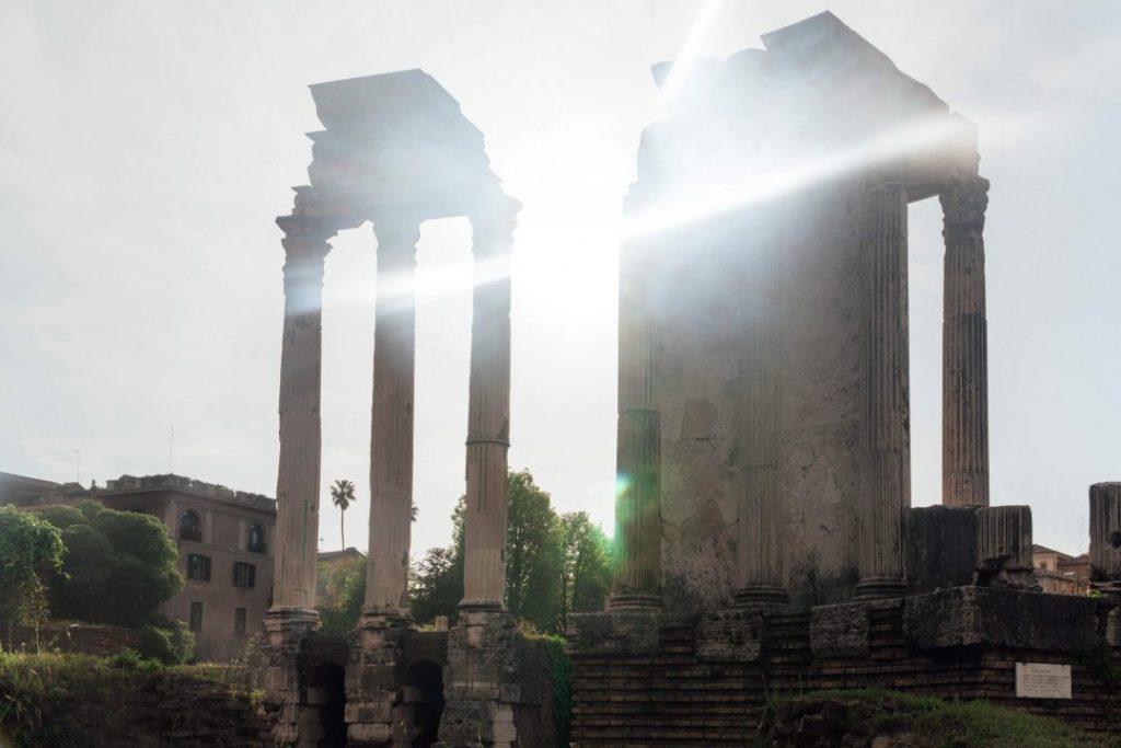 sun rays shining through columns at the Roman Forum