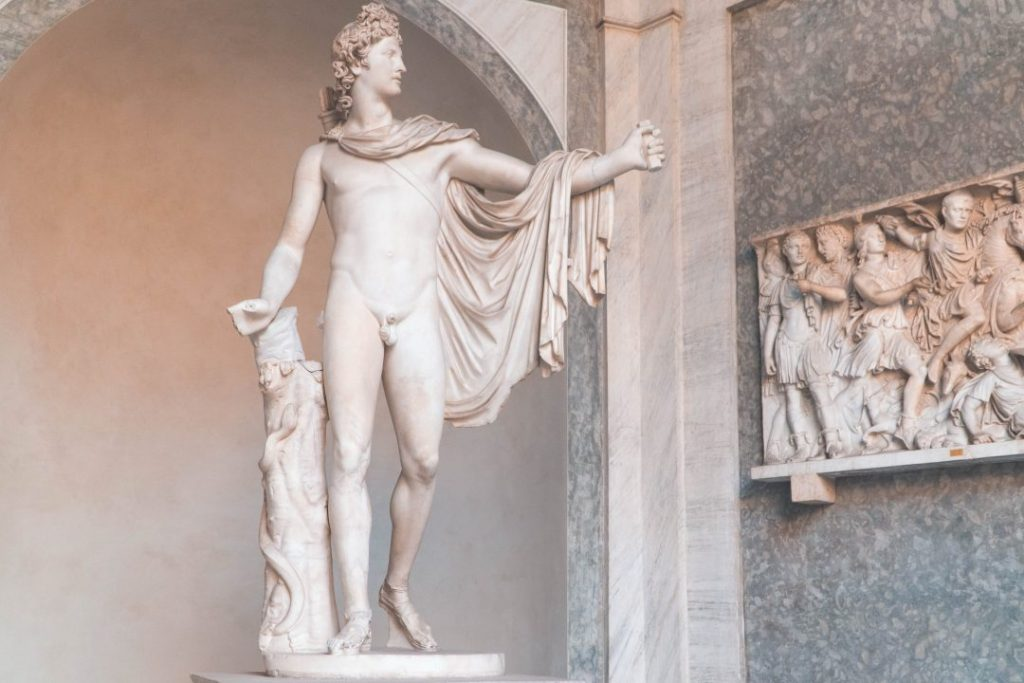 a marble statue holding its hand out